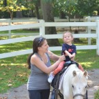 Baby's first horse ride