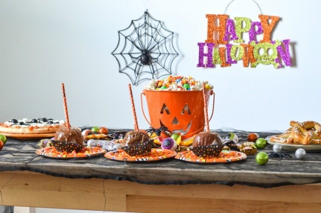 Haunted Halloween Party with Caramel Apple Place Cards and tons of candy, spider web pizza with olive spiders and more. Make a BOO Kit for your guests or let them make their own!