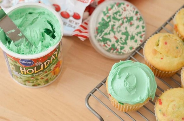 Surprise Cupcakes! Simple, easy, delicious and FUN holiday cupcake recipe! M&M's® Surprise Cupcakes with Pillsbury™ Funfetti®