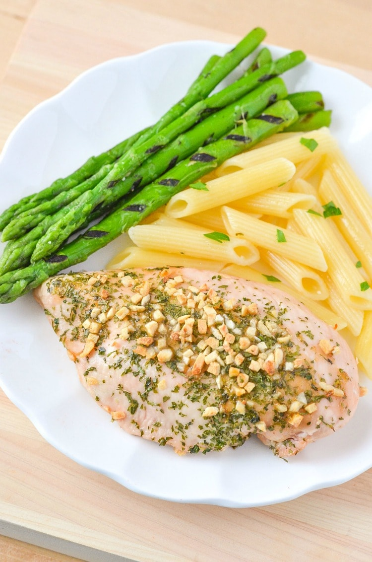 This baked chicken breast recipe makes chicken that is super moist and loaded with garlic and parsley.