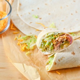 Our Chicken Burrito Recipe is super easy to make and it's so delicious. Make a perfect dinner in less than an hour. Super budget friendly meal and you can have leftovers for days by bulking up with other ingredients.