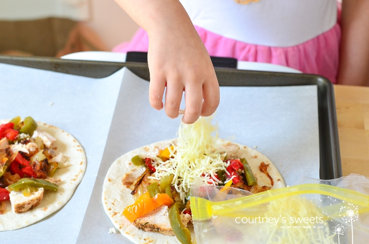 Chicken Quesadillas Recipe - Super easy restaurant style quesadillas made at home. We bake them in the oven to make them a bit of a healthier option, no frying in a pan! Kid friendly recipe on Mini Chef Mondays
