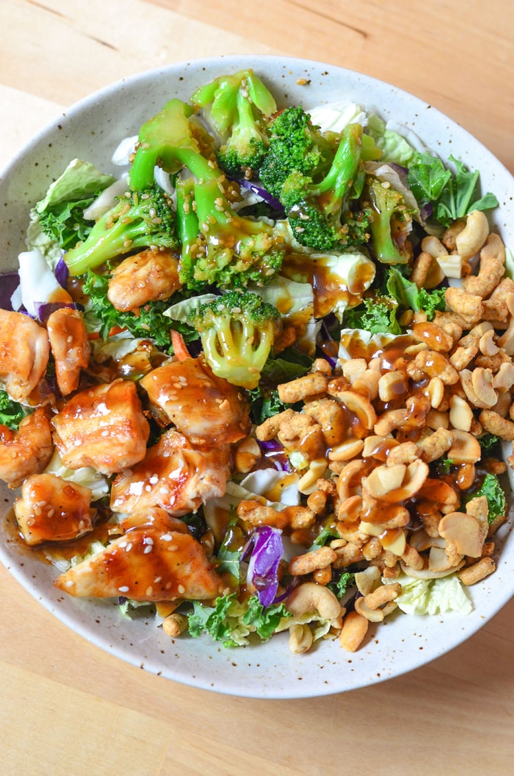 Asian Sesame Chicken Salad - a quick healthy a simple recipe for the entire family to enjoy. Filling meal and full of nuts, chicken, broccoli and beautiful, nutritious greens!