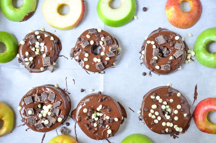 Try our delicious and healthy no bake fall treat; chocolate covered apple donuts! Freshly picked crisp apples that we covered in triple chocolate. It's a fun, healthy snack for the fall season when you pick apples. Serve to guests and wow them for sure, plus it's easy for your mini chef to help make them. :) They're a great vegetarian option so everyone can enjoy. You could even make them raw vegan treats if you choose vegan toppings.
