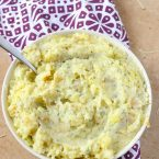 Kid Friendly Cheesy Garlic Mashed Potatoes are the perfect holiday side dish that everyone will enjoy. Vegetarian and delicious!