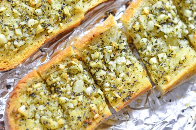 Serve our garlic bread recipe at your next dinner party! We love serving our loaded garlic bread with our Italian dinners like Sunday Sauce.