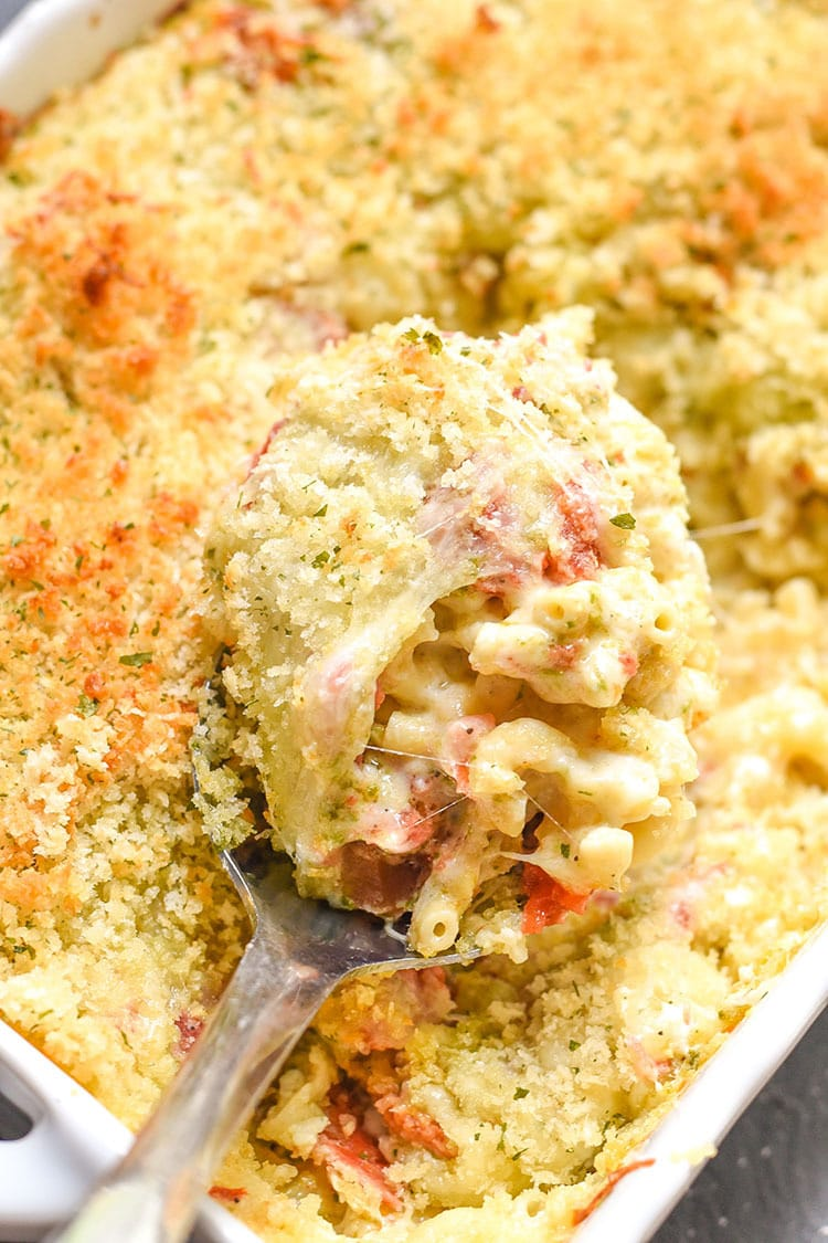 This Caprese Macaroni and Cheese Recipe is an easy meal for the family and entertaining. Tomatoes, pesto, fontina and mozzarella cheeses.