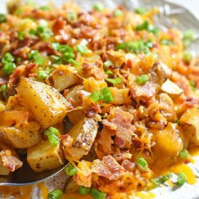 These cheesy bacon potatoes are bound to be the favorite appetizer at your holiday table. It's the ultimate comfort food recipe and hello BACON!