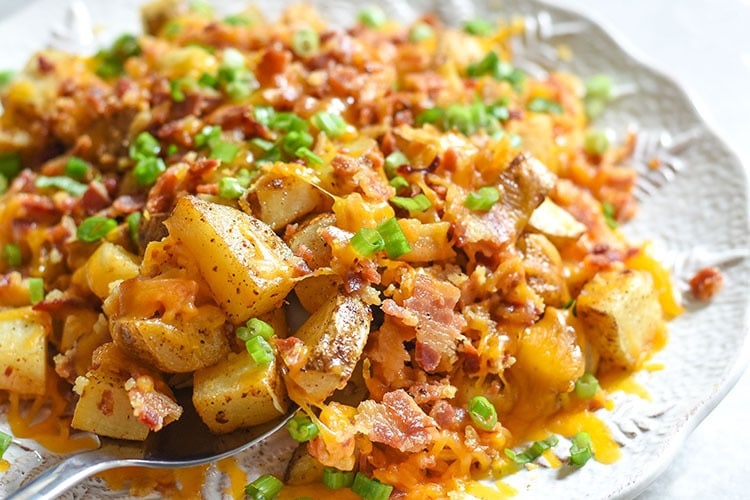 These cheesy bacon potatoes are bound to be the favorite side dish at your holiday table. It's the ultimate comfort food recipe and hello BACON!