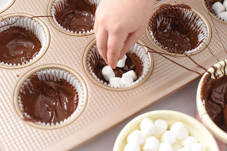 These chocolate hot cocoa cupcakes are a great way to make hot cocoa even more delicious. Great after a snow storm!