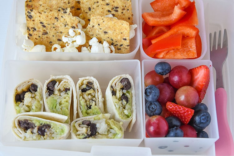 Avocado and Black beans mixed with quinoa rice complete a healthy balanced meal for your kids or even yourself! (Vegetarian Wraps Recipe)