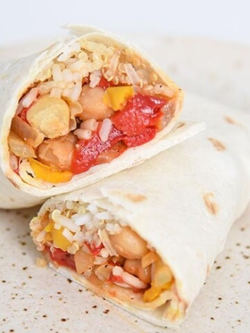 This healthy burrito recipe is not only filling, but it's also vegan! Filled with peppers, onions, chickpeas, seasoning and quinoa rice.