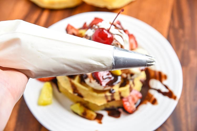 Banana Split Breakfasts are my absolute favorite. Especially this Banana Split Waffles Breakfast! Fun twist on a classic dessert recipe turned into a tasty breakfast recipe. greek yogurt