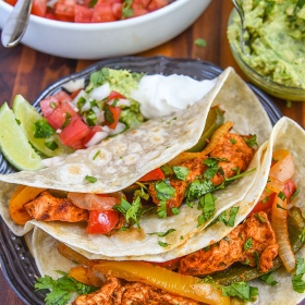 Celebrate Cinco de Mayo with homemade our Baked Chicken Fajita Recipe for dinner. Easy sheet pan meal recipe for the whole family, serve with sour cream, authentic pico de gallo or your favorite salsa recipe, fresh guacamole, and cilantro lime rice!