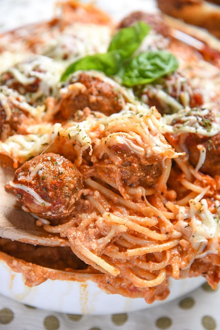 Baked Spaghetti and Meatballs is an easy dinner recipe of Italian Meatballs with Homemade Marinara Sauce, Pasta, Italian Cheese, and Spice.