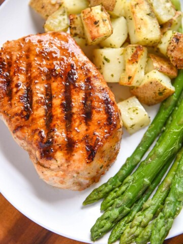 If you're looking for a pork chop marinade that's perfect for grilled pork chops or even baked pork chops this is it! It's full of flavor and a quick and easy marinade recipe. This is perfect for your family dinner or your summer bbq parties. You can even use this pork chop marinade on chicken and steak!