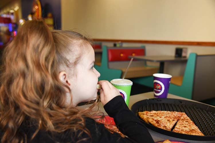 Eating at Chuck E. Cheese's