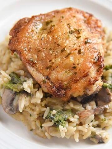 Garlic Chicken Thighs with White Cheddar Broccoli Mushroom Rice