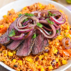 sizzling mexican steak recipe topped with onion relish