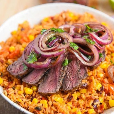 grilled steak with rice and beans