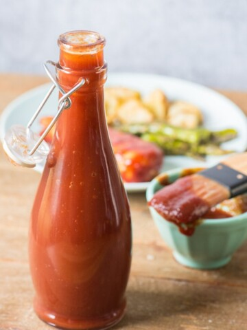 homemade bbq sauce with in open glass bottle