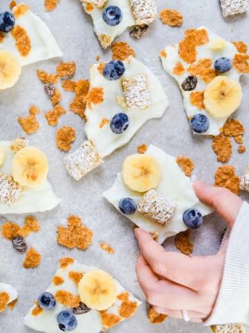 holding frozen yogurt bark breakfast cereal