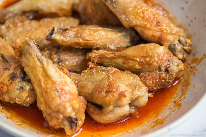 crispy air fryer chicken wings in sauce