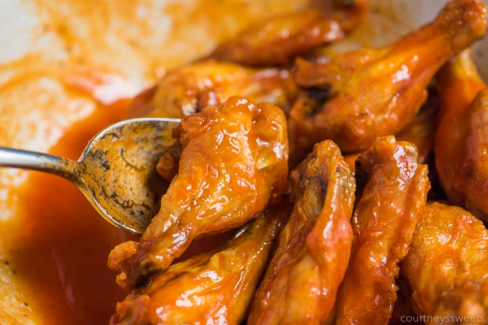 tossing air fryer chicken wings in hot sauce
