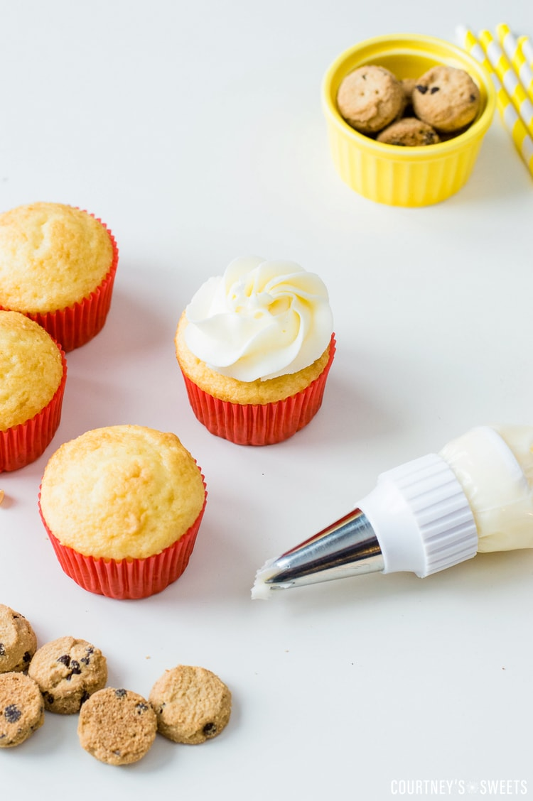 piping frosting onto cake mix cupcakes