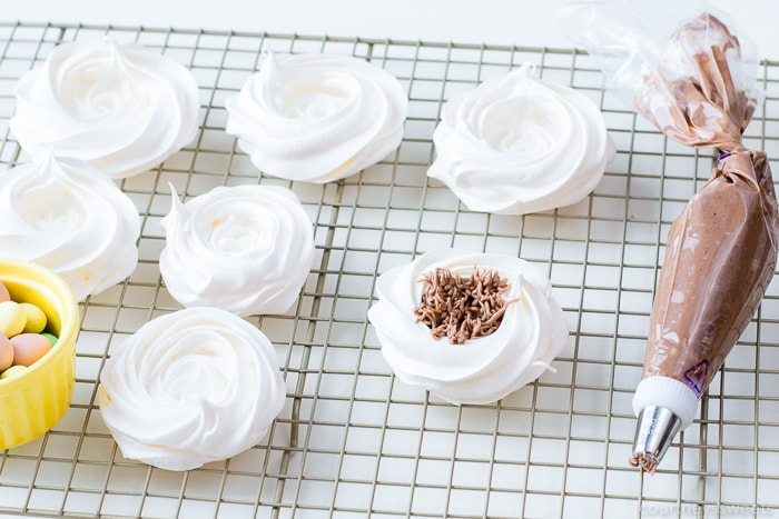 meringue nests on a baking rack