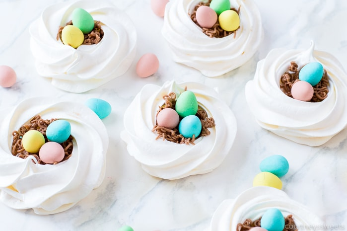 meringue nests with pastel chocolate easter eggs