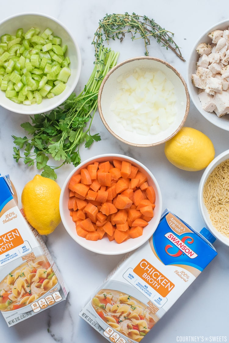 ingredients for lemon chicken orzo soup on a marble board