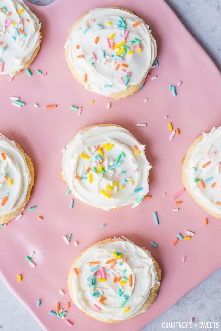 white cake mix cookies with vanilla frosting and rainbow sprinkles