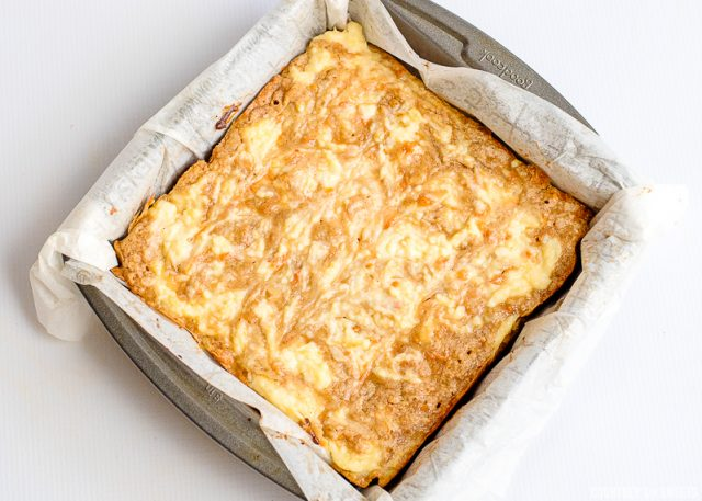 carrot cake bars with cream cheese swirl fully cooked in a baking dish