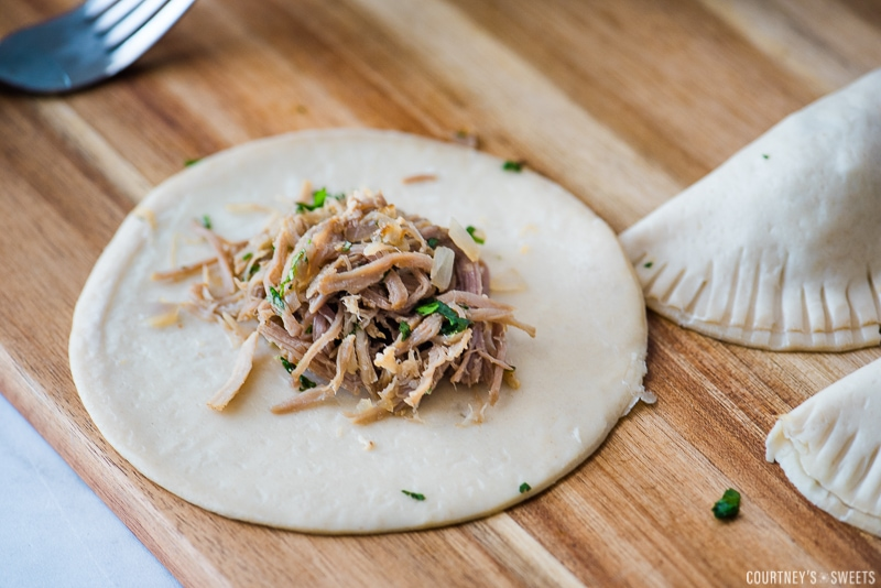 pork carnitas in empanada dough on cutting board