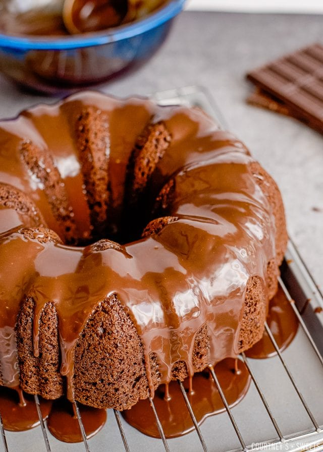 chocolate black forest bundt cake covered in ganache