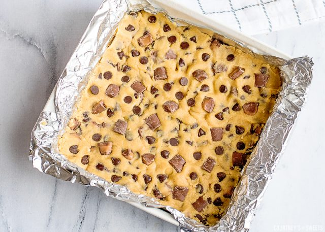 raw cookie dough in aluminum foil lined baking dish