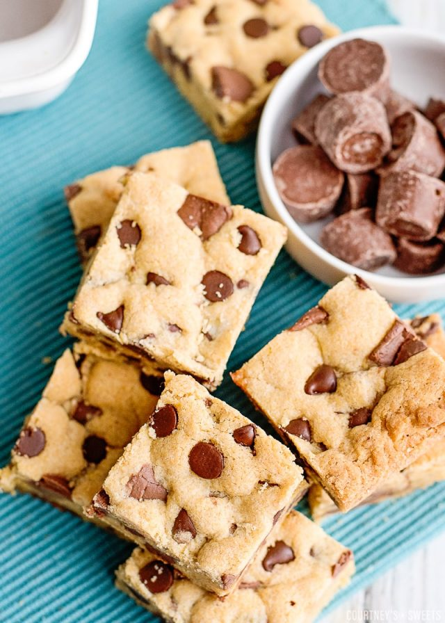 overhead photo of chocolate chip cookie bars on a teal napkin