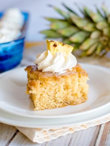 pineapple poke cake slice on a plate