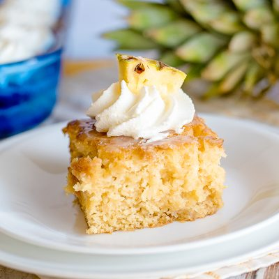 pineapple poke cake slice on a plate