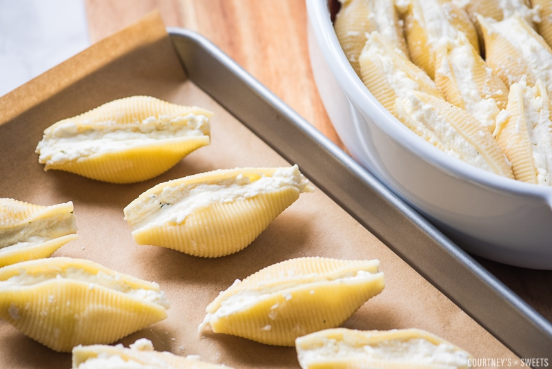 ricotta stuffed shells on a parchment lined baking sheet