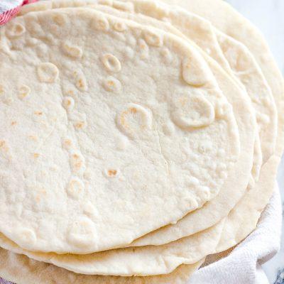 homemade flour tortillas on a clean cloth
