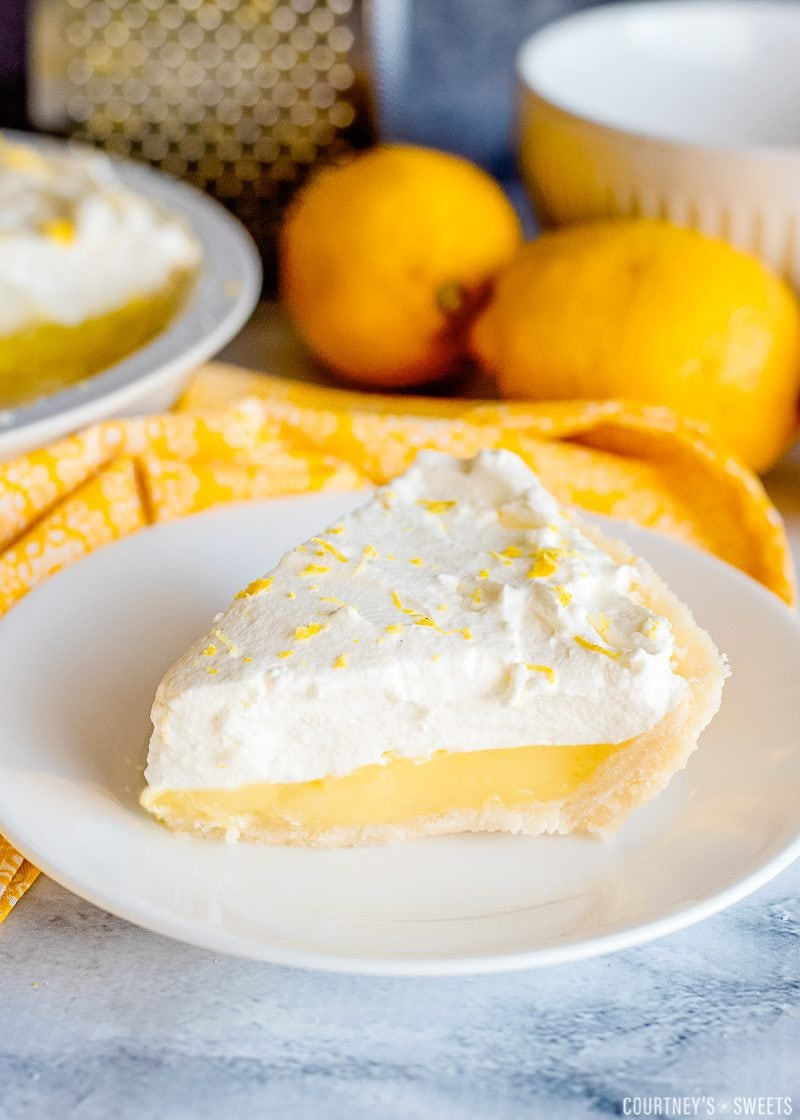 lemon pie on a plate with homemade whipped cream topping