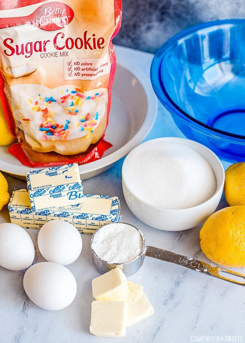 sugar cookie mix butter eggs and lemons with mixing bowl and cups
