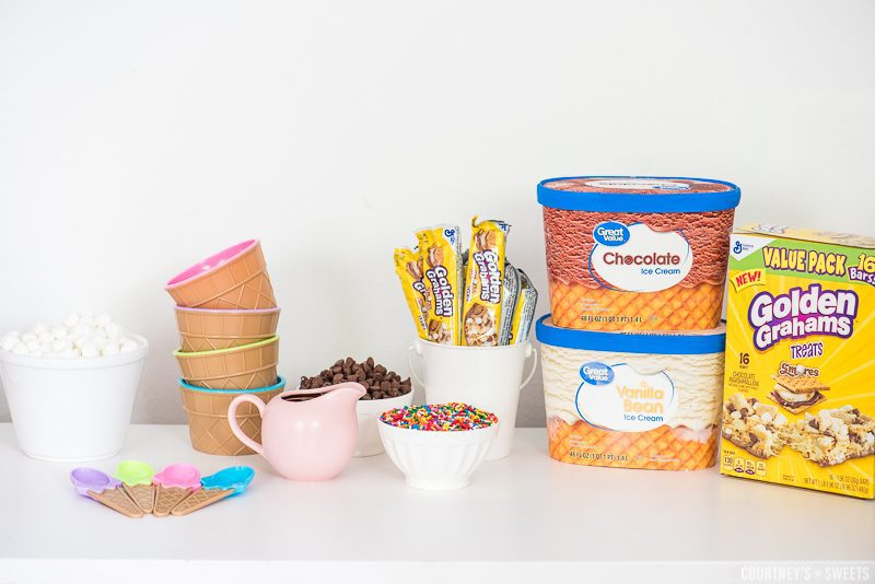 ice cream party with ice cream sprinkles chocolate and cookie bar