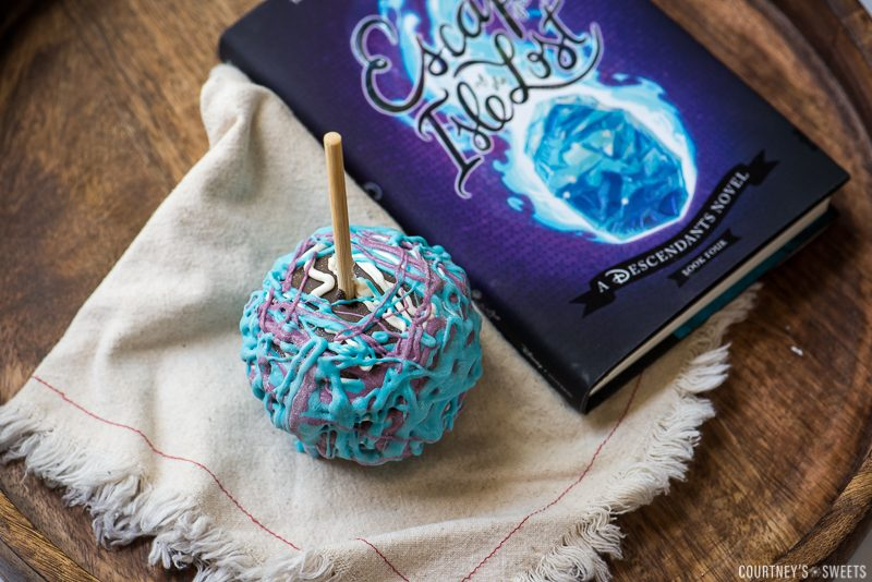 chocolate covered apple with disney descendants book on napkin