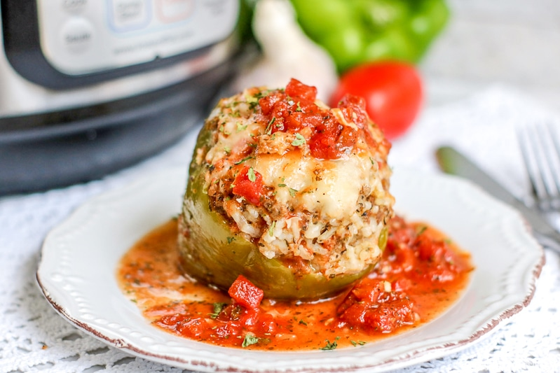 green stuffed pepper with chunky tomato sauce