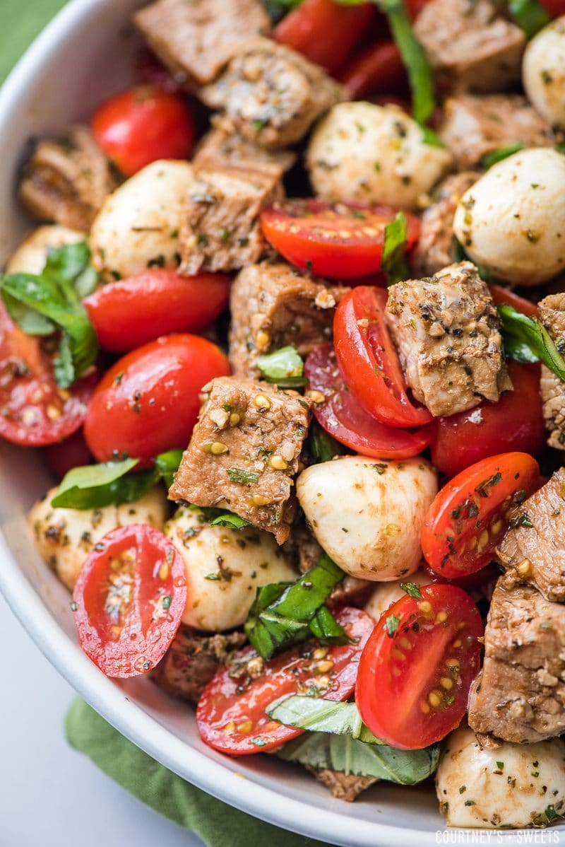 pork caprese salad in a bowl