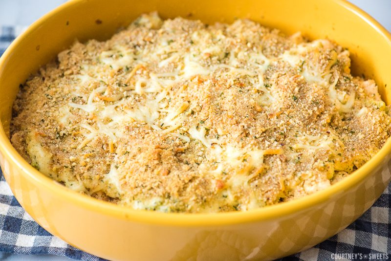 chicken broccoli rice casserole with bread crumb topping in yellow casserole dish