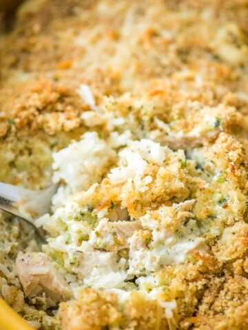 chicken broccoli rice casserole in a yellow baking dish